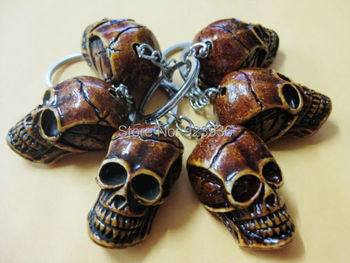 Lots 12 PCS lots puck style skeleton king yak bone skull head key-chains